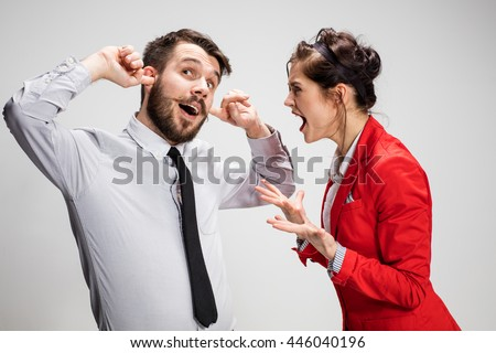 The business man and woman communicating on a gray background