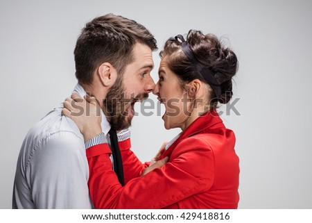The business man and woman conflicting on a gray background - stock photo