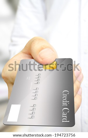 The business man in white shirt 's paying the gray credit card.