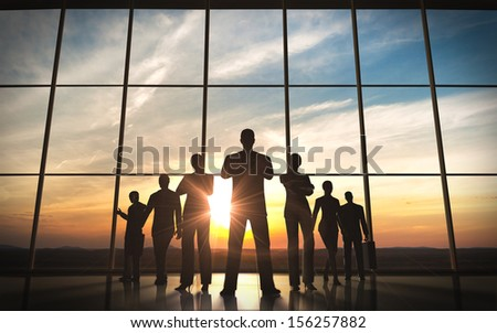The business team silhouettes - stock photo