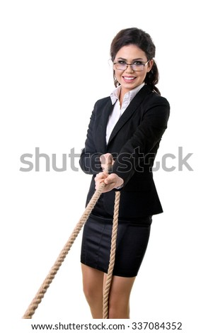the business woman pulls a rope - stock photo