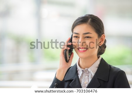 The business woman receive a good news from calling.