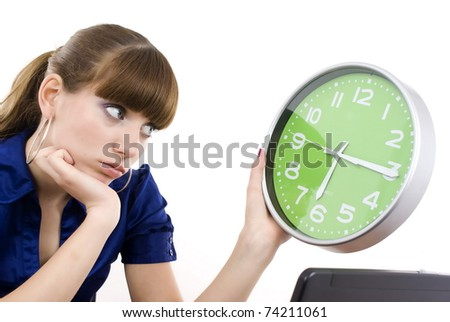 The business woman with clock in hands. It is isolated on a white background - stock photo