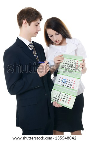The businessman and businesswoman hold a calendar - stock photo
