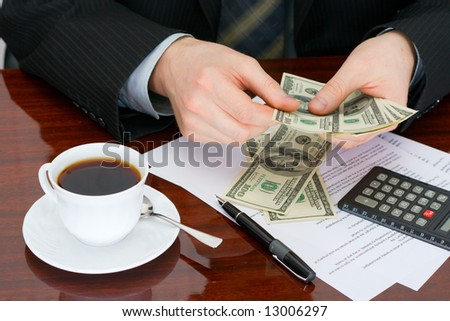 The businessman considering at office of money - stock photo