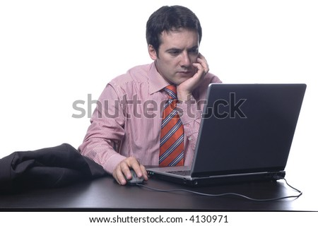 The businessman in a suit behind a table, with portable PC...