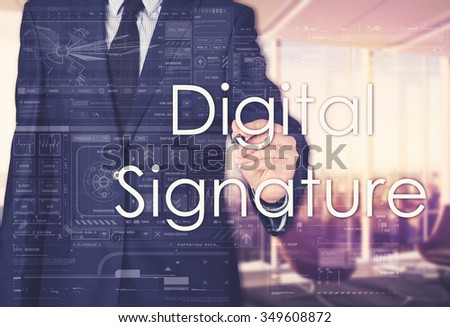 the businessman in the office is writing on the transparent board: Digital Signature - stock photo