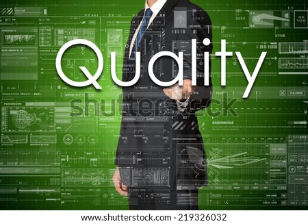 the businessman is presenting the business text with the hand: Quality - stock photo