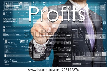 the businessman is pressing the button on the touch screen: Profits , business concept describing the modern business - stock photo