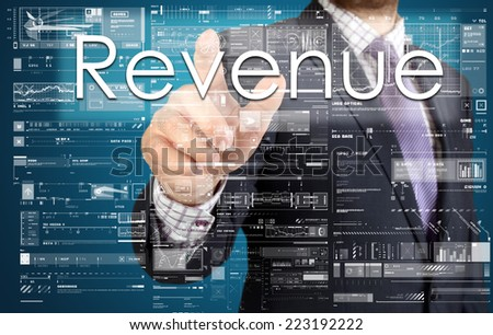 the businessman is pressing the button on the touch screen: Revenue , business concept describing the modern business - stock photo