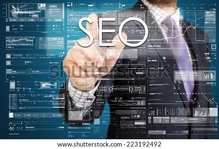 the businessman is pressing the button on the touch screen: SEO , business concept describing the modern business - stock photo