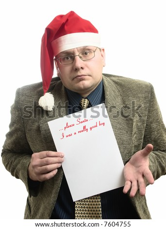 the businessman shows  own wish list for Santa - stock photo