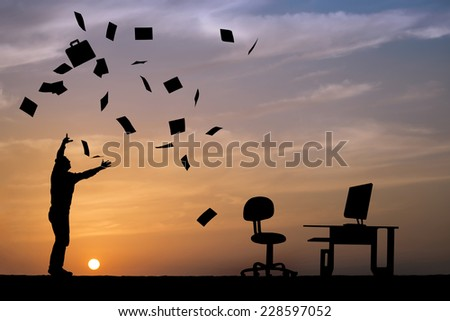 The businessman throws up his papers and briefcase - stock photo