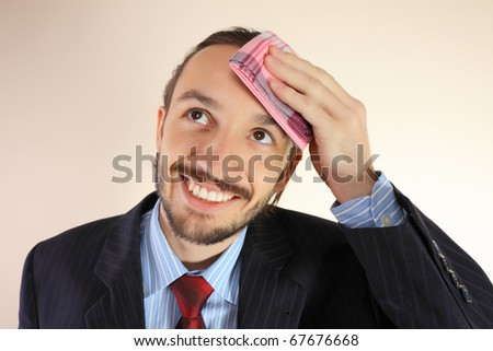 The businessman wipes a forehead by kerchief - stock photo