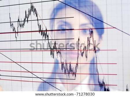 The businesswoman looks at the chart printed on a transparent material - stock photo