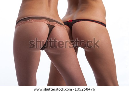 the buttocks of two girls in bikinis
