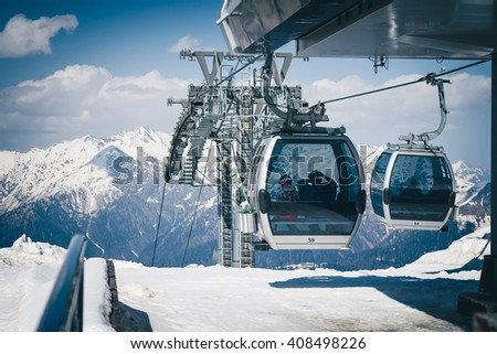The cable car up to Rosa Khutor, Sochi, Russia. There are cabins of funicular with passengers inside.