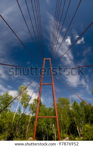 The cable-stay Whiteshell River Bridge in Whiteshell Provincial Park, Manitoba, Canada.  The bridge forms part of the Trans Canada Trail, which stretches from the Ontario border to Lake Winnipeg. - stock photo