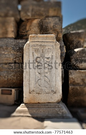 The Caduceus, universal symbol of medicine in ruins of Ephesus,Turkey. Useful file for your brochure about antiquity, travel and archeology.