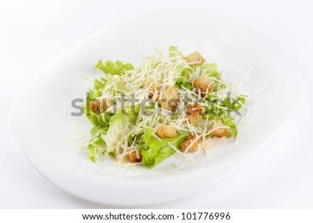 The Caesar salad prepared on the classical recipe - stock photo