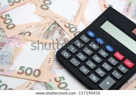 The calculator and money isolated on white background - stock photo