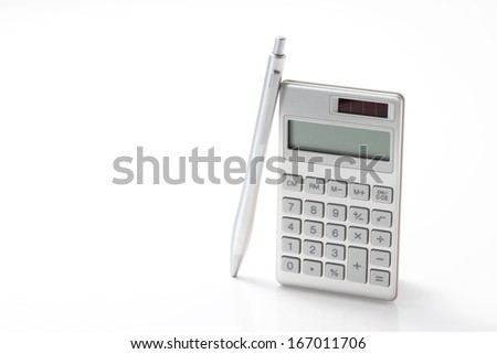 The calculator and pen on white background - stock photo