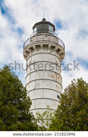 The Cana Island Lighthouse, in Door County, Wisconsin, shines its light for vessels on the western side of Lake Michigan. - stock photo