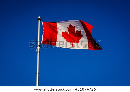 The Canadian Flag at Centre Island, in Toronto, Ontario. - stock photo
