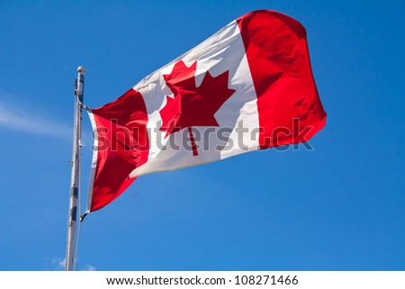 The Canadian flag, flapping in the wind - stock photo
