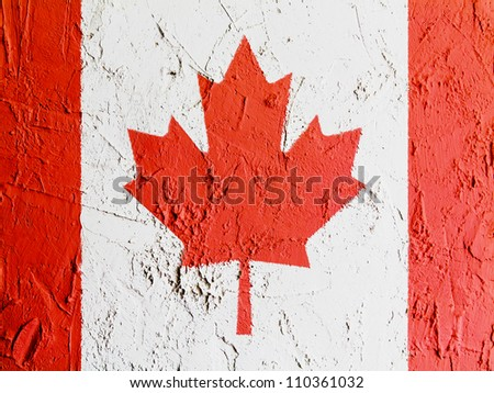 The Canadian flag painted on wall - stock photo
