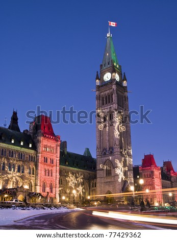 The canadian Parliament at dusk during the festive season. - stock photo