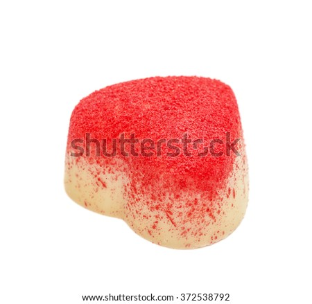 The candy from white chocolate in the form of heart strewed with a red sugar crumb, isolated on the white - stock photo