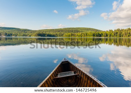 The canoe on the lake in the canadian park - stock photo