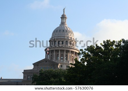 the capital dome rising over trees - stock photo