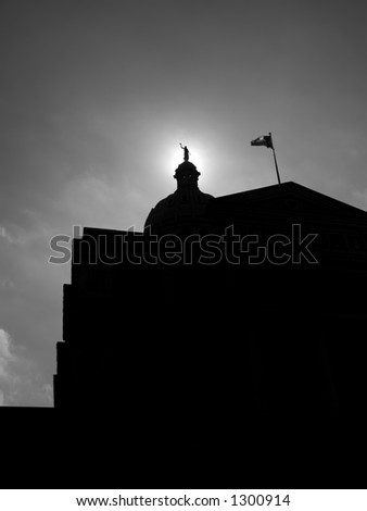 The Capitol building of the state of Texas in Austin, Texas, set againts a partially cloudy blue sky. - stock photo