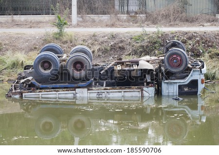 The car fell into the water and capsized - stock photo