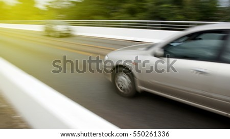 The car is on the road fast and blurred images.