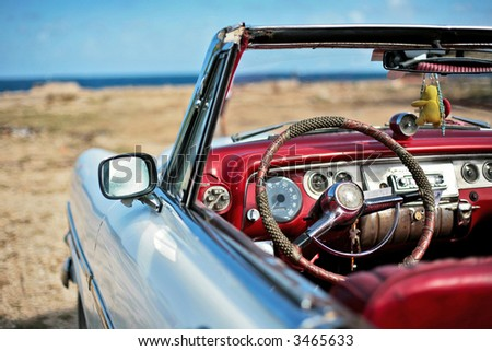 the car is parked on seacoast of havana - stock photo