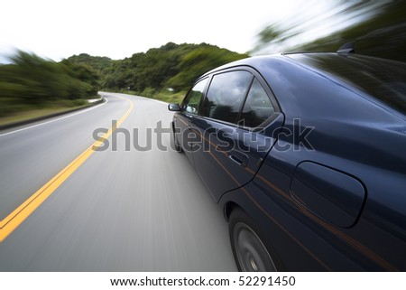 The car moves at great speed at the mountain road