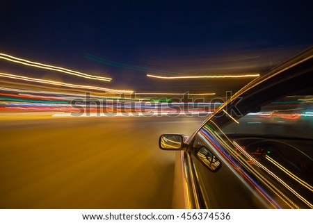 The car moves at great speed at the night. - stock photo