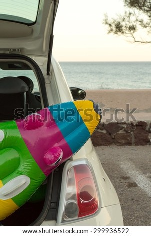 The car trunk full of beach accessories