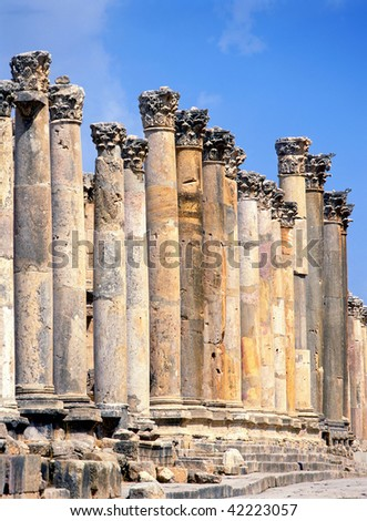 "The Cardo or ""Colonnaded Street"". Paved with the original stones - the ruts worn by chariot wheels still visible - the 2500 foot Cardo was the architectural spine and focal point of Jerash. - stock photo"