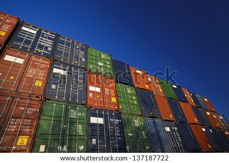 The cargo containers which are storing on the open area of the port terminal - stock photo