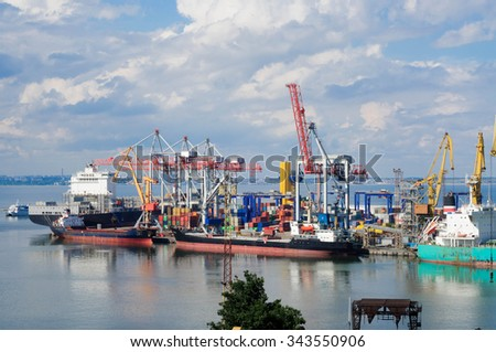 The cargo ship is unloaded at the port - stock photo