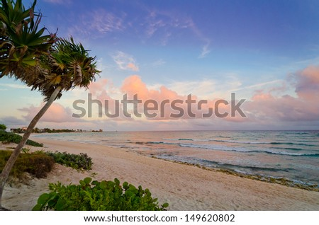 The caribbean ocean lagoon, beach of the luxury mexican resort at the sunset, sunrise, dawn, evening time. - stock photo