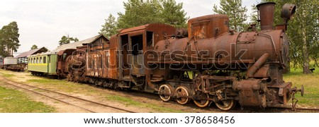 The cars and locomotive are in an abandoned depot of the narrow gauge Railways. Pereslavl-Zalessky. Russia. - stock photo