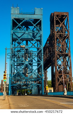 The Carter Road lift bridge with a railroad lift bridge next to it on the right, spanning the Cuyahoga River in Cleveland Ohio - stock photo