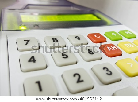 The cash register isolated that prints checks - stock photo