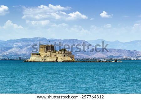 The castle of Bourtzi is located in the middle of the harbour of Nafplio. The Venetians completed its fortification in 1473 - stock photo