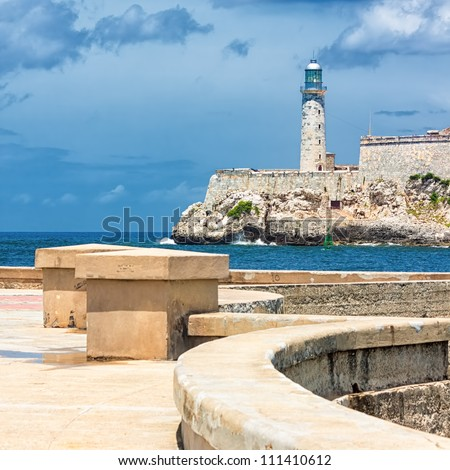 The castle of El Morro, a symbol of Havana, with the famous promenade known as El Malecon - stock photo
